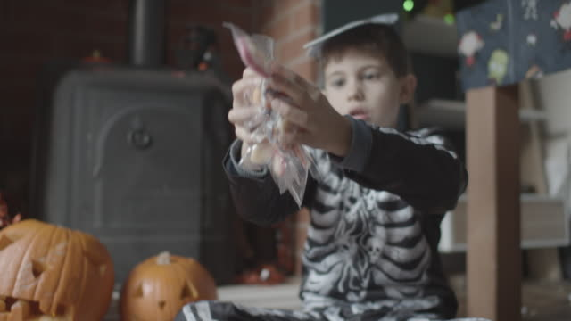 boy with halloween candies - tilt down stock videos & royalty-free footage
