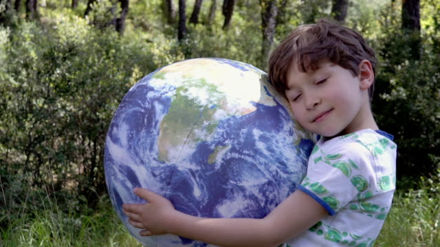 boy with inflatable earth ball - care stock videos & royalty-free footage