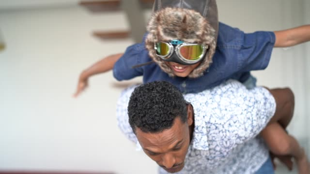 boy with pilot glasses play fly with his dad at home - single father stock videos & royalty-free footage