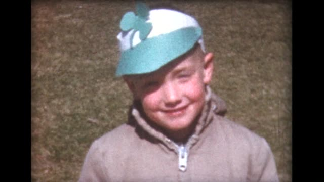 1961 boy with shamrock cap plays with dog and friends - st. patrick's day stock videos and b-roll footage