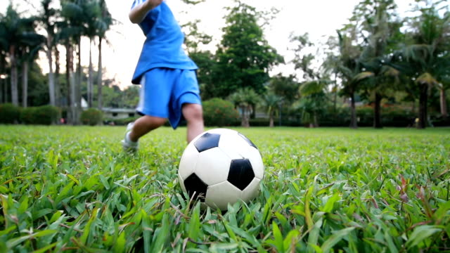 boy with soccer ball, hd slow motion - kicking stock videos & royalty-free footage
