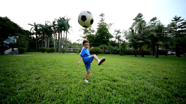 Boy with soccer ball, HD SLOW MOTION