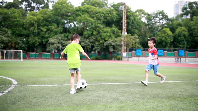 boy with soccer ball - education building stock videos & royalty-free footage