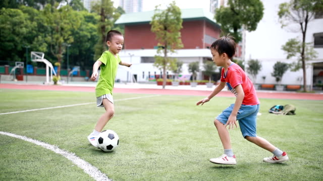 boy with soccer ball - grass family stock videos & royalty-free footage