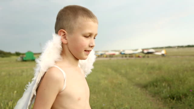 boy with wings on the airfield