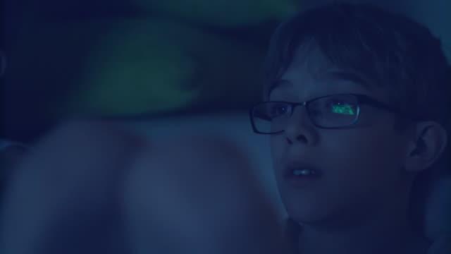 boy yawning while watching tv at night - yawning stock videos & royalty-free footage