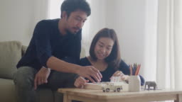 Boyfriend and girlfriend are playing wood toy at home.