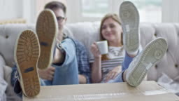 Boyfriend and Girlfriend Relaxing on Sofa