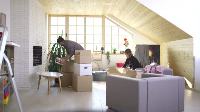 boyfriend and girlfriend unpacking stuff in new home - tenant stock videos & royalty-free footage