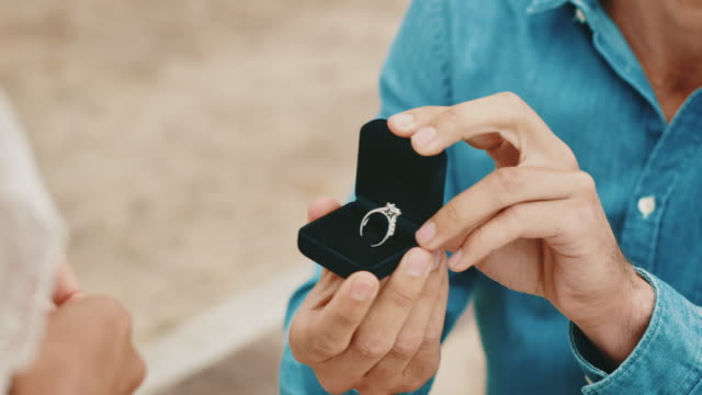 boyfriend holding ring while proposing girlfriend - engagement stock videos & royalty-free footage