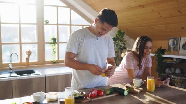 boyfriend preparing breakfast for his girlfriend in the kitchen - sunny stock videos & royalty-free footage