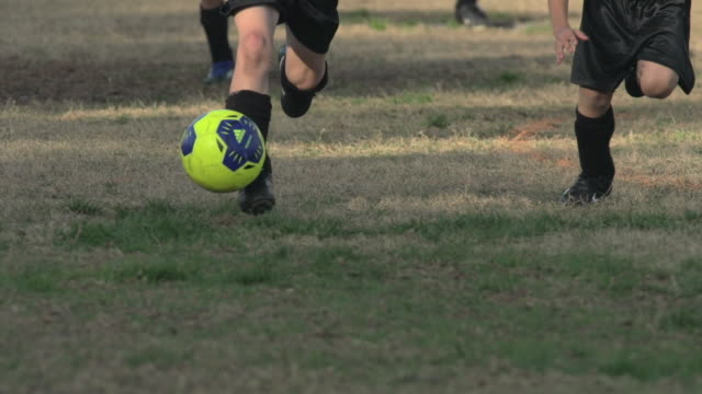 boys ages 6 to 8 playing in a youth soccer league game. - slow motion - goodsportvideo stock videos and b-roll footage