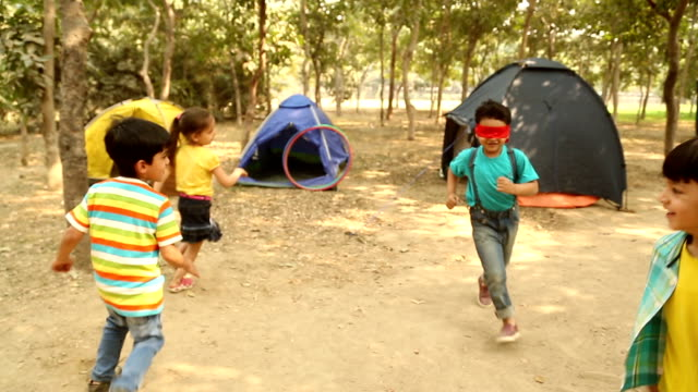 boys and girl playing hide and seek, delhi, india - blindfold stock videos and b-roll footage