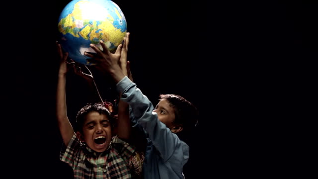 Boys and girls carrying world globe