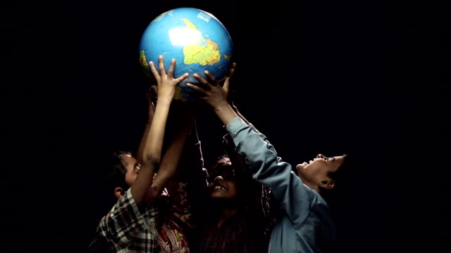 Boys and girls carrying world globe