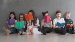 Boys and girls reading books