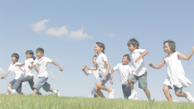 boys and girls running jumping - elementary student stock videos & royalty-free footage
