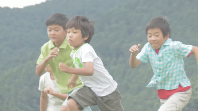 boys and girls running - elementary student stock videos & royalty-free footage