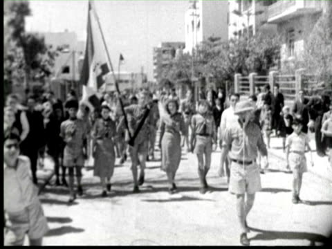 b/w  boys and girls scout at street, palestine / audio - boy scout stock videos and b-roll footage