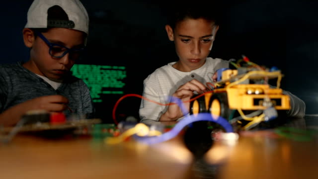 boys assembling robotics together - genius stock videos & royalty-free footage