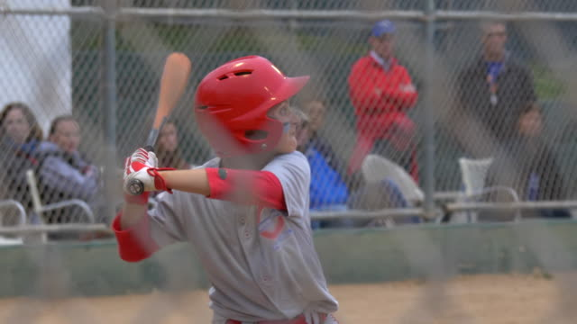 boys batting and playing little league baseball game. - slow motion - batting sports activity stock videos & royalty-free footage