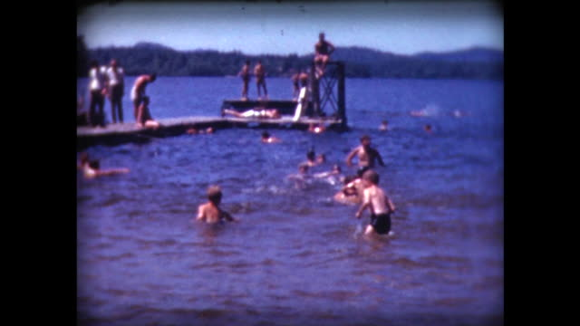 vídeos de stock, filmes e b-roll de 1941 boys camp, boys splashing in lake - home movie