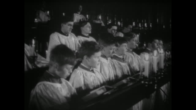 boys choir sings, a soldier father comes home and the people of london celebrate christmas in the air raid shelters of the underground - 賛美歌点の映像素材/bロール