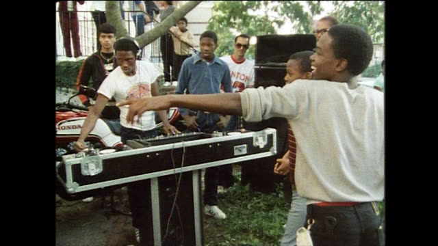 boys dance and body pop in front yard party; new york, 1984 - jeans stock videos & royalty-free footage