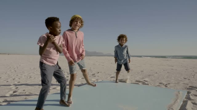 boys dancing and playing at beach - barefoot stock videos & royalty-free footage