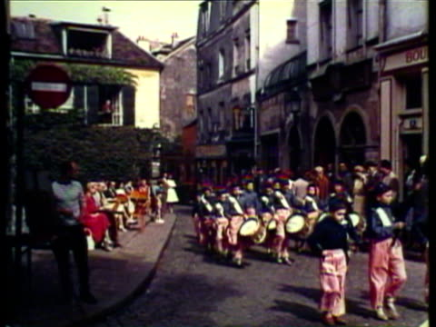 1953 WS Boys dressed in (No Suggestions) costumes marching in parade, one boy holding French flag / France / AUDIO