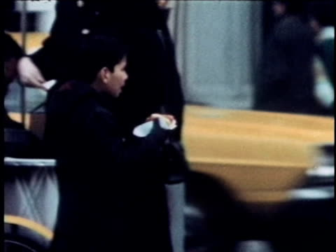 1968 montage boys eating hot-dogs and exploring city, new york city, new york, usa, audio - anno 1968 video stock e b–roll