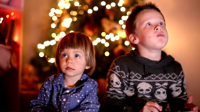 boys enjoying christmas eve indoor - sibling stock videos & royalty-free footage