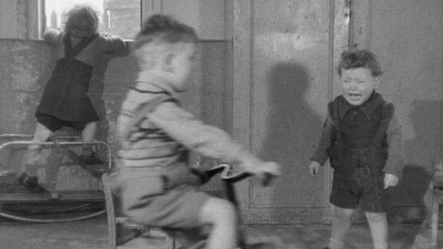 1947 ws boys fighting over tricycle / united kingdom - tricycle stock videos & royalty-free footage