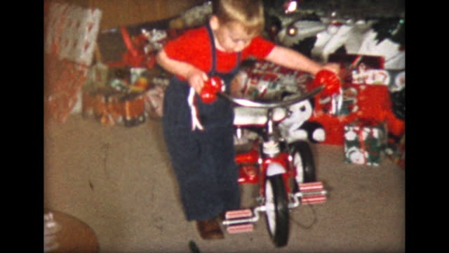 1957 boy's first ride on christmas tricycle - tricycle stock videos & royalty-free footage