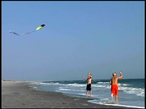 boys flying kites at beach - see other clips from this shoot 1335 stock videos and b-roll footage