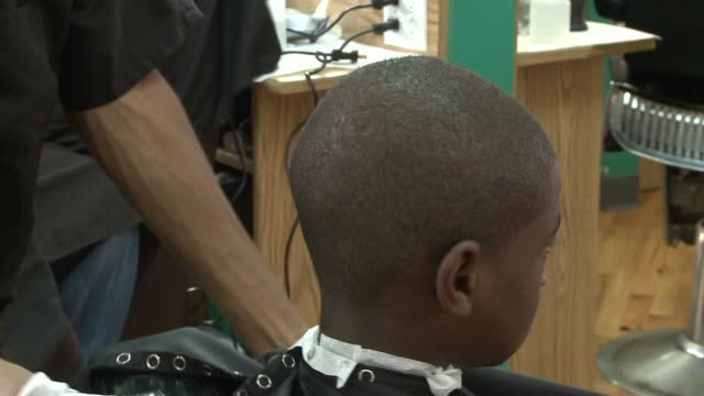 wgn boys getting their hair cut in barber shop on august 24 2013 in chicago illinois - barber shop stock videos and b-roll footage