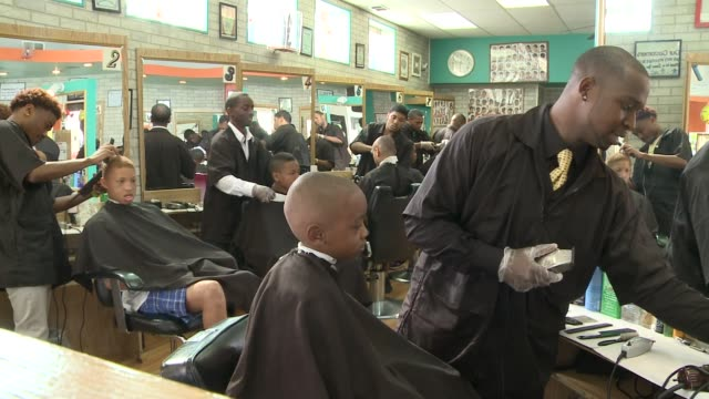 boys getting their hair cut in barber shop on august 24 2013 in chicago illinois - barber shop stock videos and b-roll footage