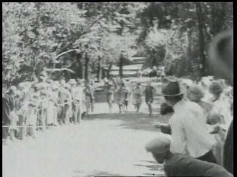1924 ws boys, girls, and men participating in running races / detroit, michigan, united states - 1924年点の映像素材/bロール