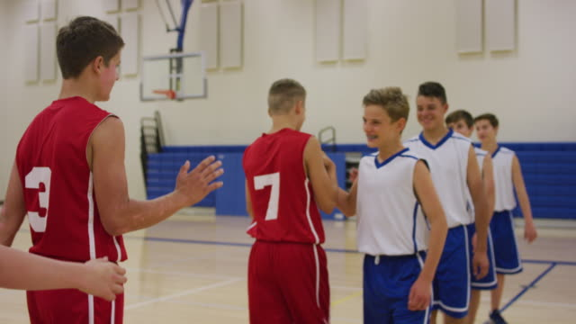 boys giving high-fives after a game - basketball sport stock videos & royalty-free footage