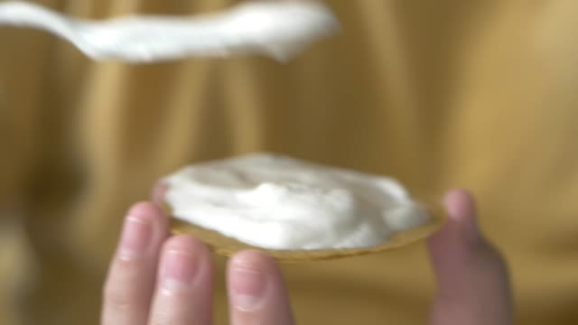 boy's hands spreading cream and dessert topping on food, lifestyle concept. - dessert topping stock videos & royalty-free footage