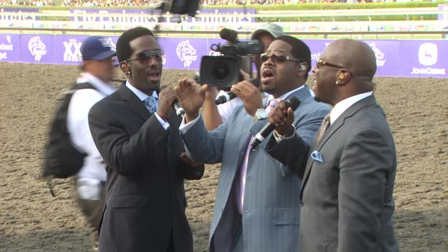 boys ii men at the breeders' cup world thoroughbred championships at arcadia ca. - world war ii stock-videos und b-roll-filmmaterial