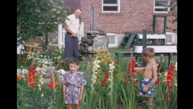 1953 montage boys (3-5) in backyard, parents preparing barbecue / canada - perfection stock videos & royalty-free footage