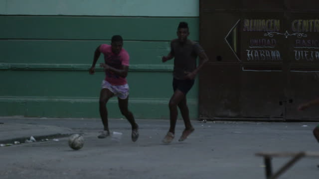 Boys in Cuba play soccer, slow motion