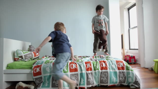ws boys (17 months, 2-5 years) jumping on bed in bedroom / brooklyn, new york city, usa - mischief stock videos & royalty-free footage