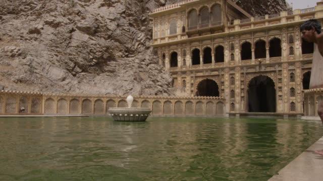 boys leap into pool at galtaji temple, jaipur, india - bbc stock videos & royalty-free footage