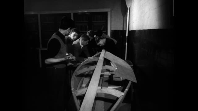 boys learn to build a boat in a youth club; 1960 - youth club stock videos & royalty-free footage
