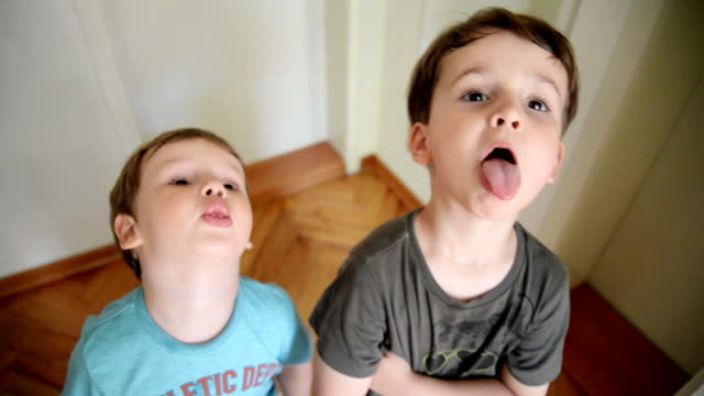 boys looking at camera and making faces - human tongue stock videos & royalty-free footage