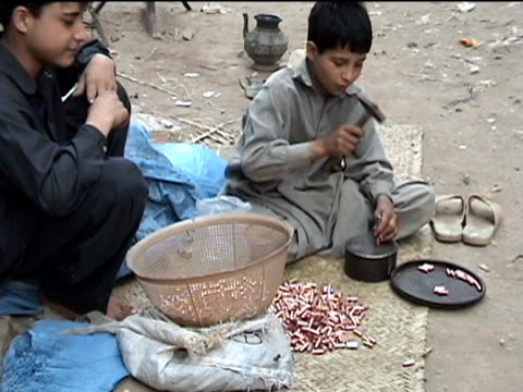 ws boys manually making bullets in middle of street darrah district in tribal zone at afghan border federally administered tribal areas pakistan audio - geographical locations stock videos & royalty-free footage