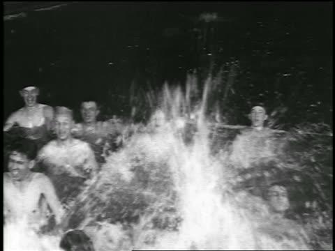 b/w 1920 boys + men swimming + splashing in swimming pool / detroit, michigan / newsreel - only men stock videos & royalty-free footage