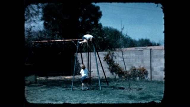 boys on swing 1960's - rebellion stock videos & royalty-free footage